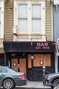 Comet Club closed while the neon sign still remains lit.