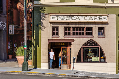 People looking around, waiting in the entrance of Tosca Cafe.