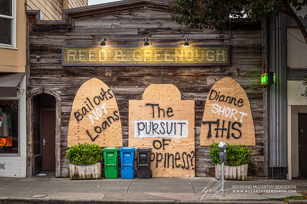 "Reed & Greenough's piano bar has a feeling of old west with graffitti written on the boarded up windows, ""Bailouts NOT Loans.  The Pursuit of Happiness? Dianne SHORT THIS."""