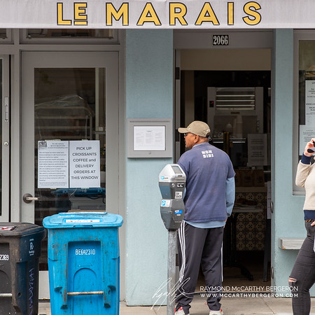 Le Marais bakery keeps doors open by setting their cash register and offerings close to the door; all prebagged items.