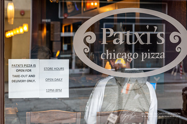 Some stores like Patxi's has people waiting inside to pick up their food.