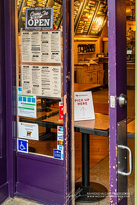 Squat & Gobble's make-shift order/pickup window using tables and taping a menu up in the window for guests to see without needing to touch.