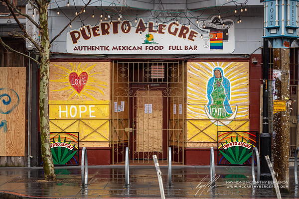 Positive Art is found on business' plywood like Puerto Alegre's store front.