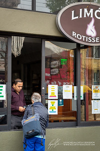 Limon Rotisserie staff takes order at window for take out only.