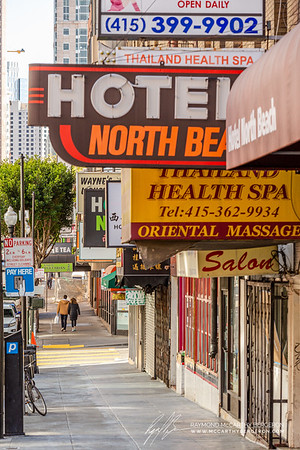 A couple walks down a quiest street in North Beach.