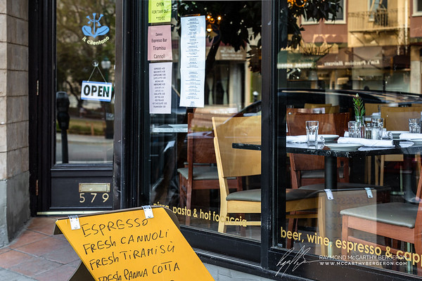 Il Cilentano remains open but for take out with a select menu posted on the window.
