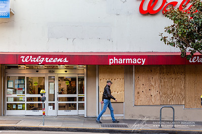 Walgreens is open for business, but boarded up their windows for this part of town.