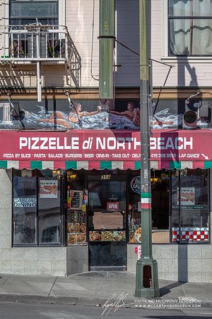"Pizzelle di North Beach posts on a makesift cardboard box sign ""Goto Window"" for ordering takeaway."