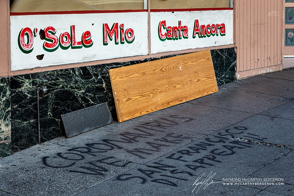 """""""Coronavirus We Make San Francisco Disappear!!"""" spray painted on a sidwalk outside a business."""