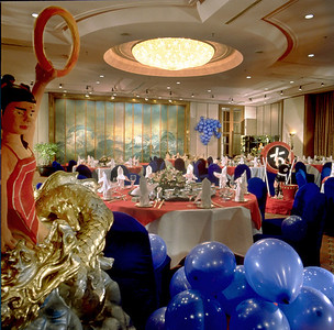 "Telling a Story within the confines of a ""property shot"" was embraced by Starwood, and using props creatively was expected when I was shooting internationally for, them and for Resorts and Great Hotels.  Here in Tien Jin China I insisted on 50 blue balloons and an ice sculpture to show off the banquet room, which was otherwise deadly.  I was informed no ice, no ice artists in that part of china, but did I want to look at the butter sculptures.   Hey, worked for me!"