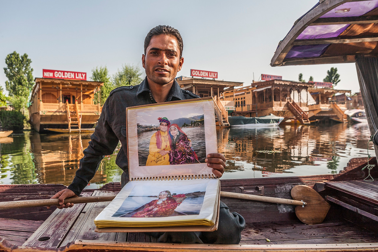 Photographer  on the Dal lake in Srinagar, Kashmir