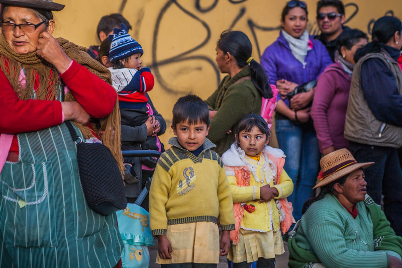 People of Tupiza watching the Virgin of Guadalupe festival in Bolivia