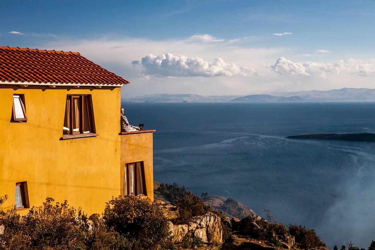 Soaking in the sun and looking at Peru on Isla del Sol, Lake Titicaca, Bolivia