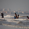 Children enjoying a swim in the Juhu beach in Mumbai