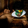 Kathakali artists applying make-up before a show