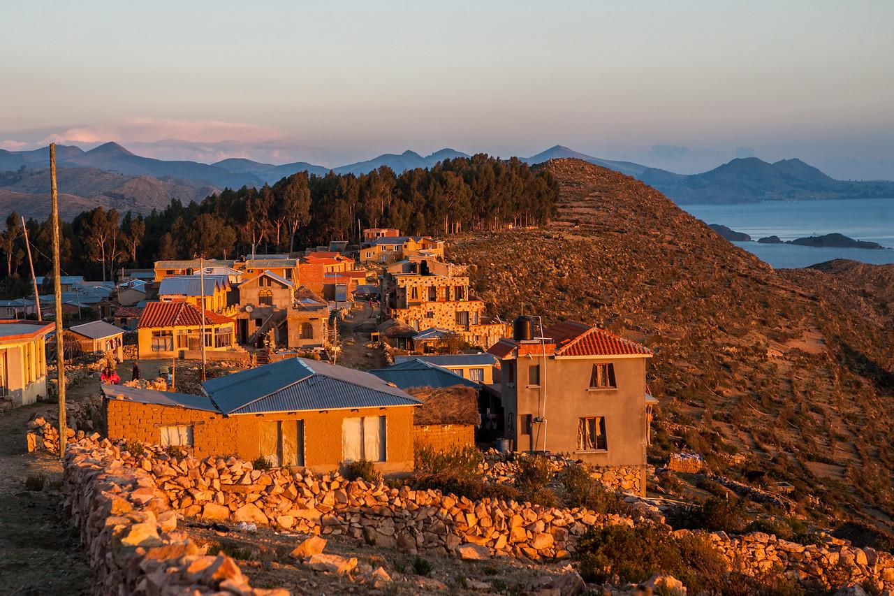 Village Yumani soaking in the sun at sunset on Isla del Sol, an island on Lake Titicaca in Bolivia