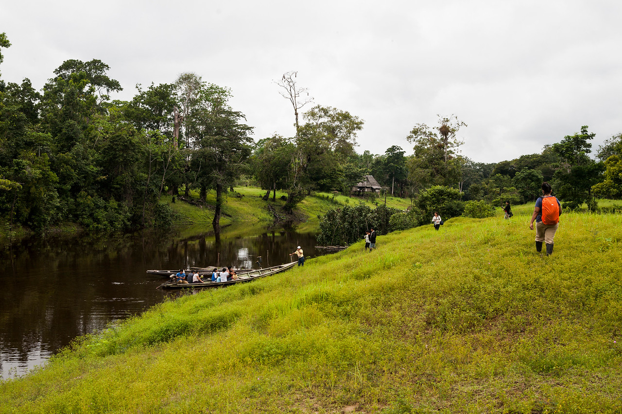 Getting onto the boat after visiting a village in the Amazon rainforest, Peru