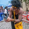 Woman taking photos of tiles at Santa Teresa, Rio de Janeiro, Brazil