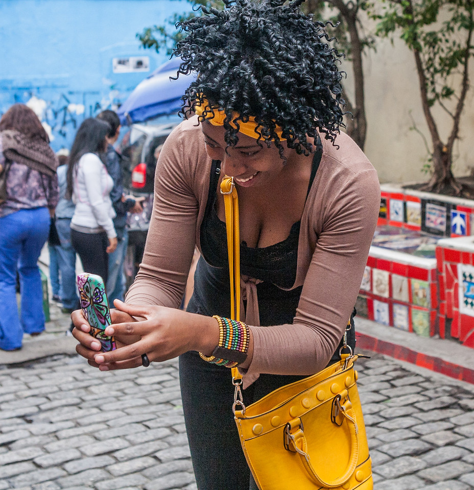Woman taking photos of tiles at Santa Teresa, Rio de Janeiro, Brazil