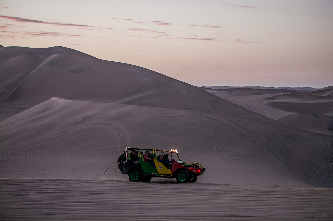 Roller coaster buggy rides on the sand dunes of Huacachina near Ica, a city in Peru