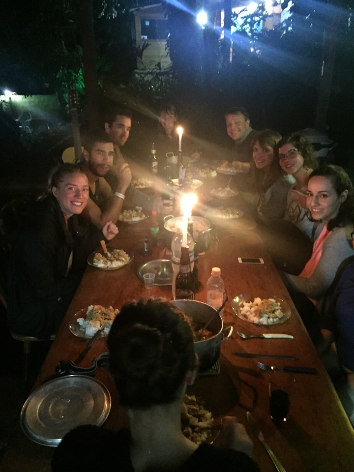 HI hostel group having dinner, Ilha Grande, Brazil