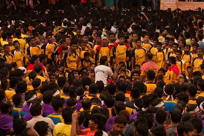 The dahi handi group, govinda pathak listens in rapt attention to their coach before forming the human pyramid on the occasion of Janmashtami, the birthday of Lord Krishna at an event in Thane, a suburb of Mumbai.
