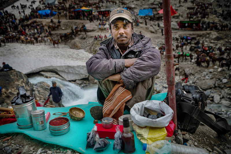 Man selling fake saffron and black blocks of shilajeet outside the holy Amarnath cave.