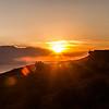 Sun setting over the Peruvian mountains over the horizon seen from Isla del Sol, in Lake Titicaca, Bolivia