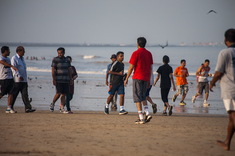 People arrive at the Juhu beach in Mumbai for a morning walk