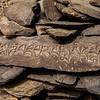 Tibetan scriptures carved on rocks in Zanskar