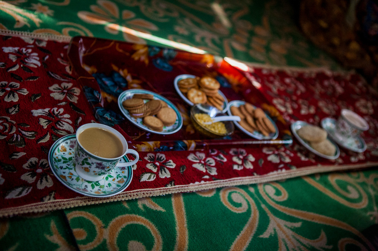 Tea with snacks at a family home in Kolam Chinar, a village with sulphur springs in Kashmir