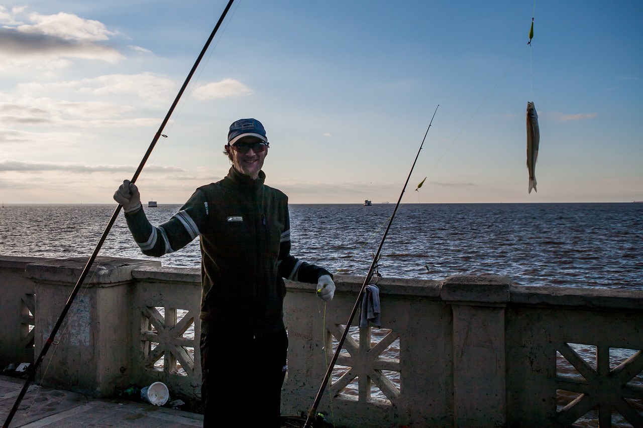 Fishing by the Rio de la Plata riverfront in Buenos Aires, Argentina