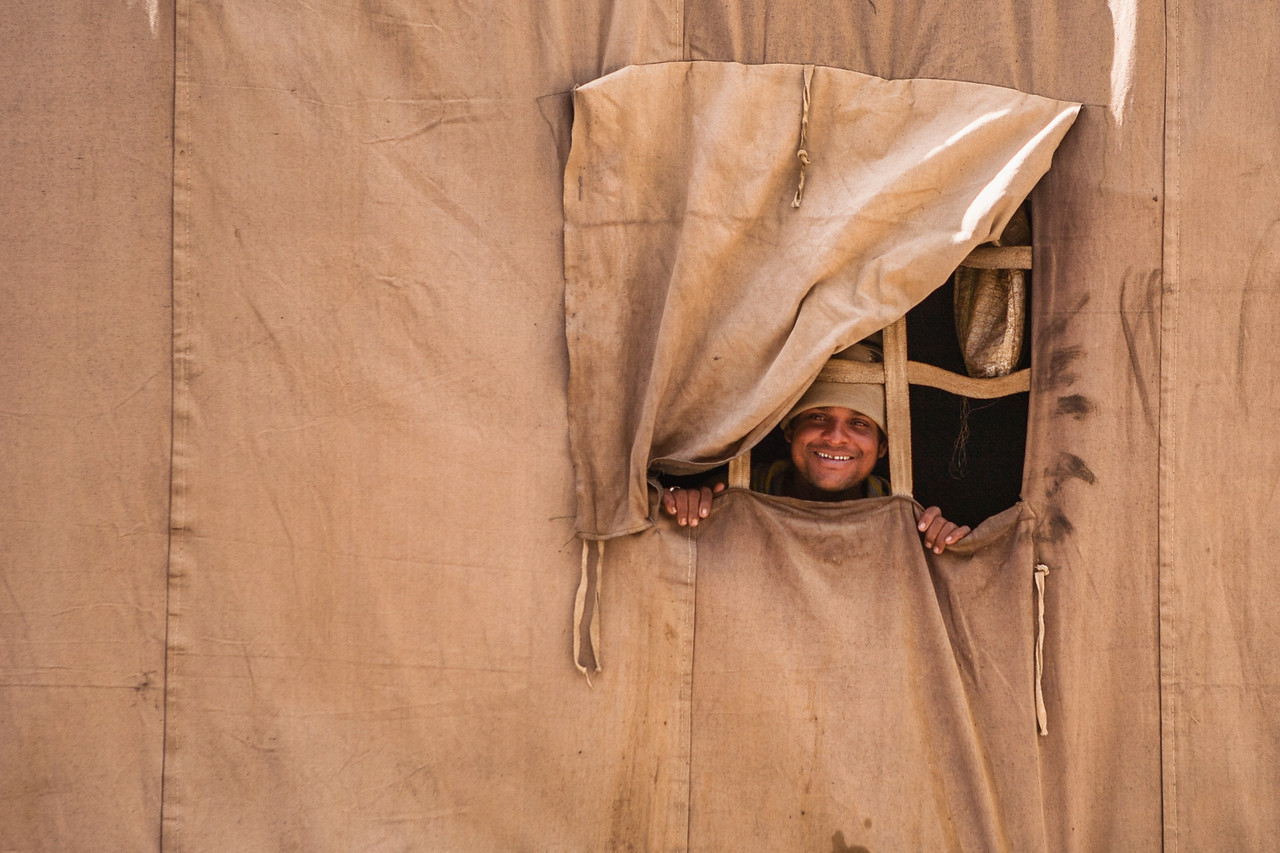 Worker from tent winodow, Tanglang la, Leh-Manali Highway, India
