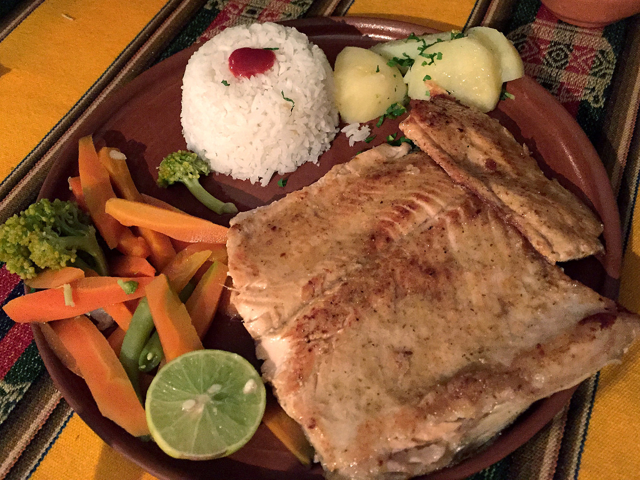 Dinner of grilled trout on Isla del Sol, lake Titicaca, Bolivia