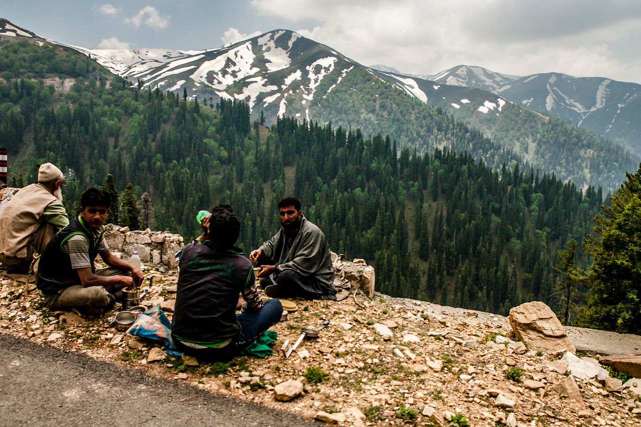 Construction workers repairing the road to Sinthan Top in the summer months, Kashmir