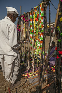 Farmer buys accessories like bells and colourful belts for his cattle at the cattle fair where farmers trade their cattle specially their bulls or bullocks in the market town of Rajur in rural Maharashtra, India.