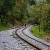 Walk along the railway tracks en route Aguas Calientes near Machu Picchu, Peru