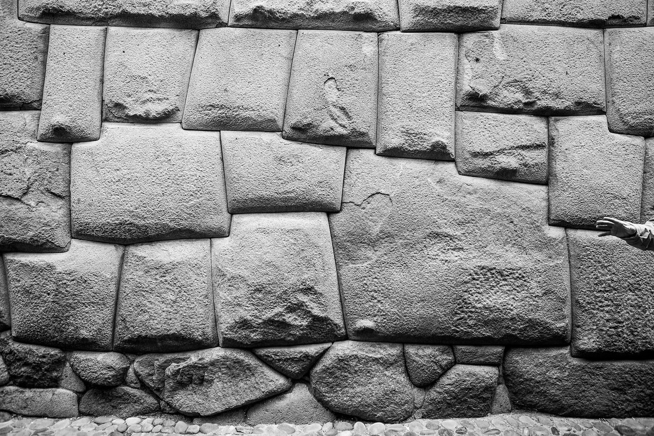 Twelve cornered stone, part of the original Incan wall, Cusco, Peru