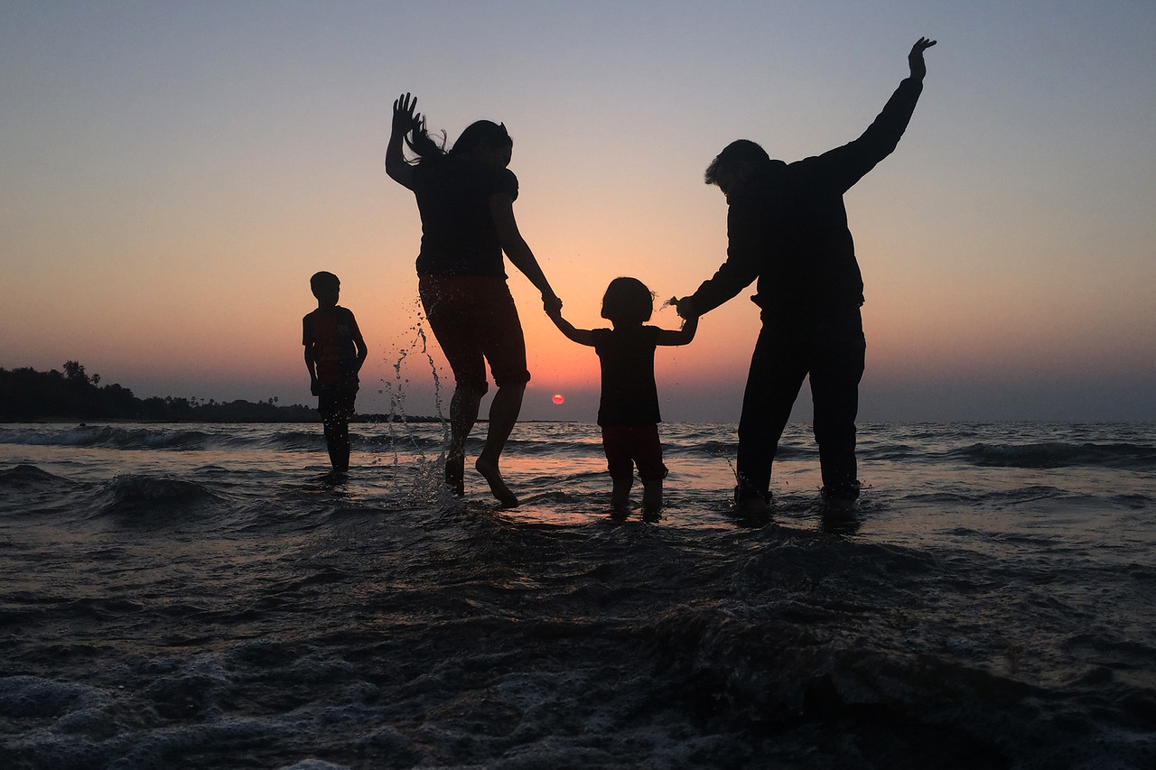 Family enjoying their time together at Aksa beach in Mumbai