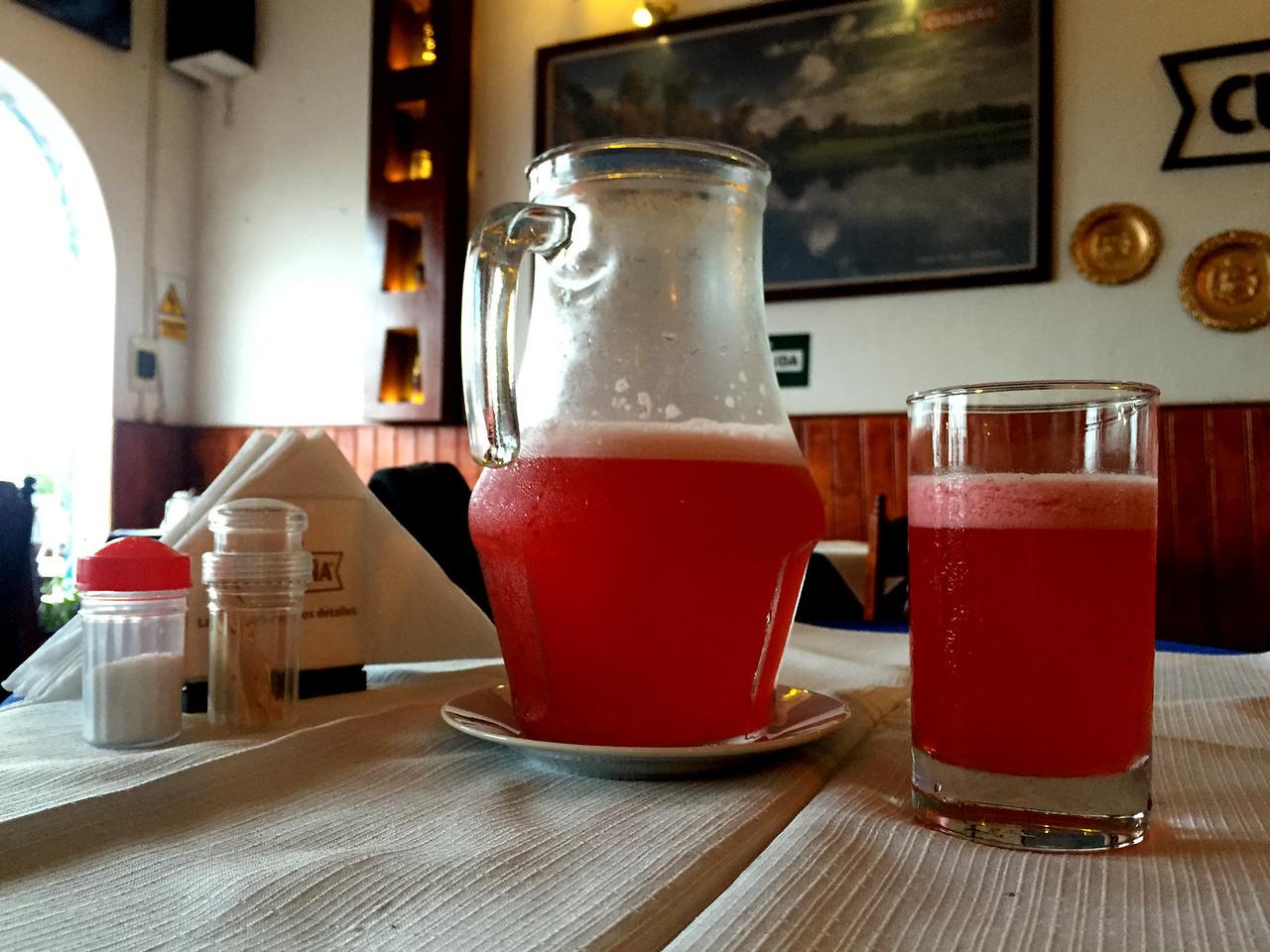 Jar of chilled kamu kamu juice, the famous citric fruit of the Amazon rainforest