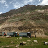 Trucks halting at the village Parkachik in Suru valley near Kargil on their way to Zanskar valley, India