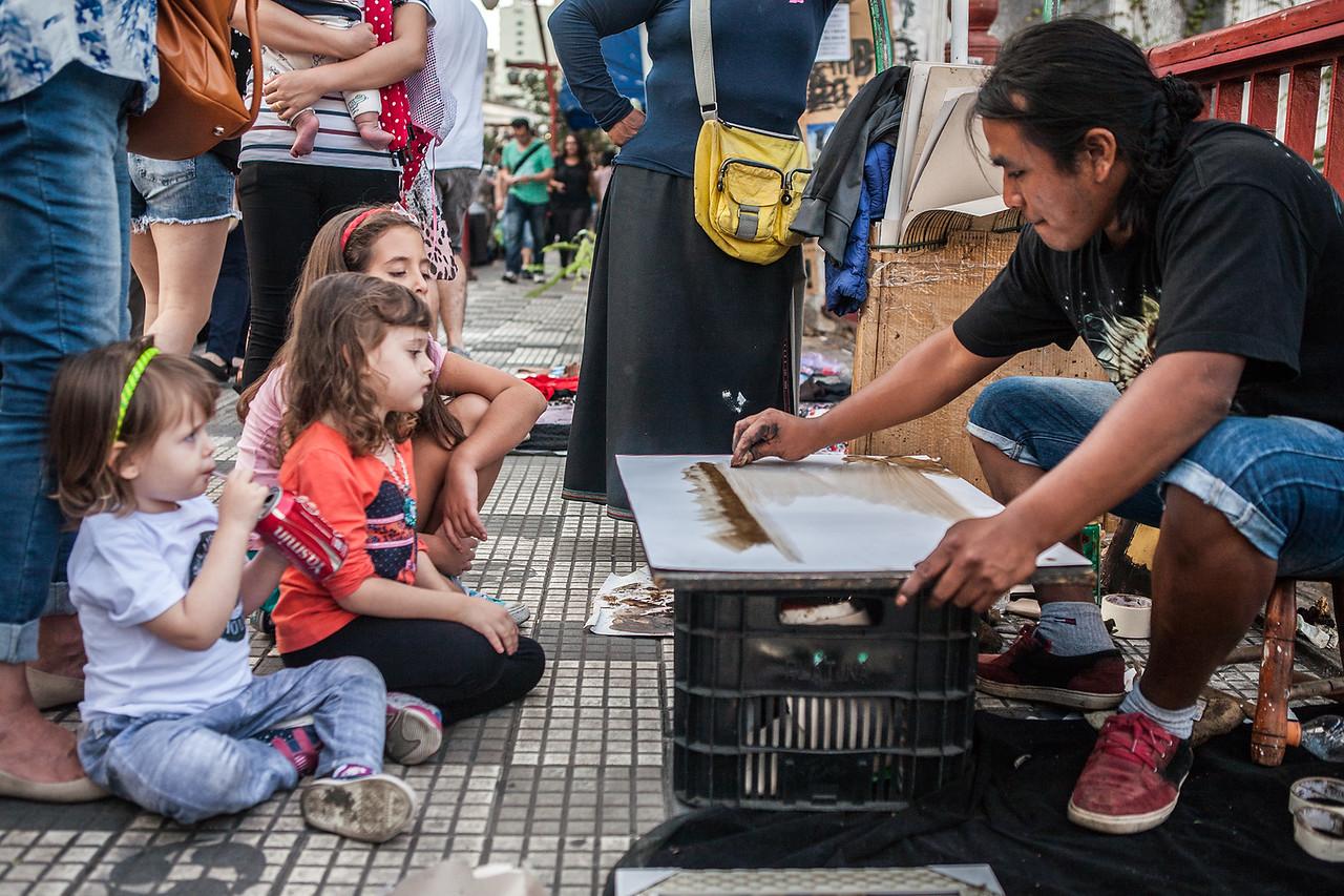 Kids watching sande art at Japanese Market, Sao Paulo, Brazil