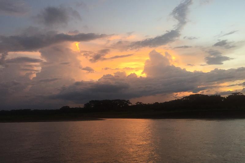 The sun setting over the Amazon, Peru