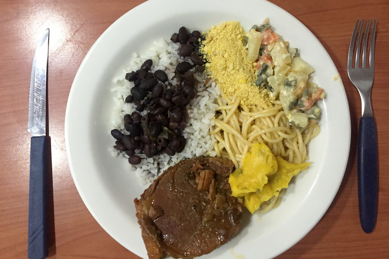 Delicious meal of steak, black beans, rice, pasta and salad