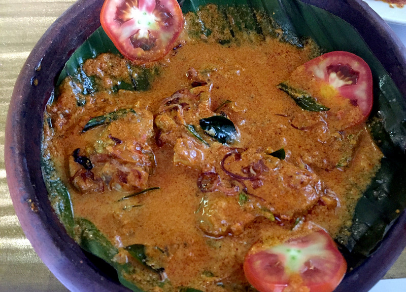 Seafood lunch of fish and coconut curry with appams in Fort Kochi, Kerala