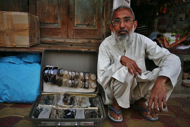 Street vendor selling glasses in Ahmedabad, India