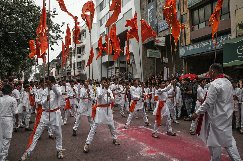 School children perform the traditional 'flag dance' at Ganesh festival in Pune, India