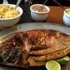 Tambaqui de banda, a famous Amazon fish at a local restaurant in Manaus, a major city in the Amazon forest, Brazil