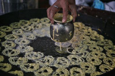 Jalebee being prepared at the oldest jalebee shop in Ahmedabad on the occasion of  Makar Sankranti, the kite flying festival.