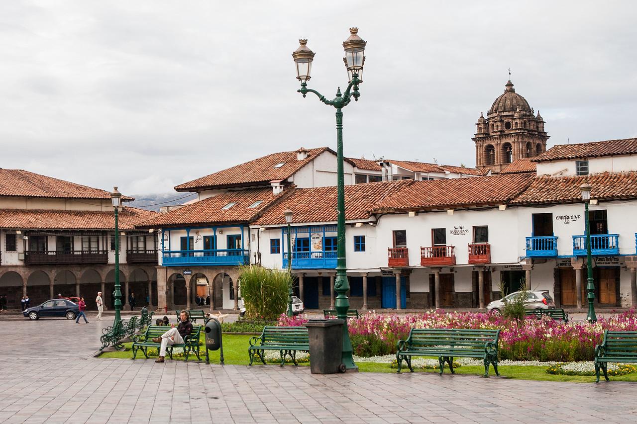 Shops in old buildings at Plaza de Armas, Cusco, Peru